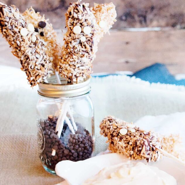 A mason jar filled with bananas that have been dipped in chocolate and rolled in coconut and nuts.  The addition of eyes makes this a perfect fruit based Halloween treat.