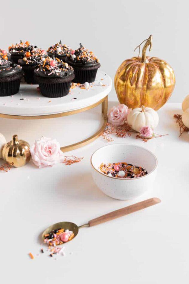 These Halloween themed cupcakes are very glamorous.  The dark black velvet cupcake is frosted with black frosting and sprinkled with what appear to be pears and shiny sparkles.