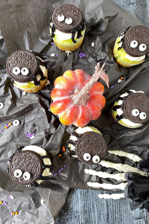 This Halloween themed cupcake is a yellow cake cupcake frosted with white frosting, topped with an oreo that's topped with two eyes.  Black gel frosting creates legs on the oreo spider that's on top.